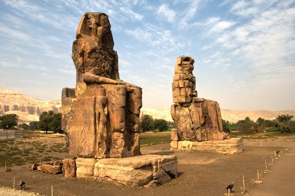 A photograph of The Colossi of Memnon, near Luxor, Egypt. Shutterstock.