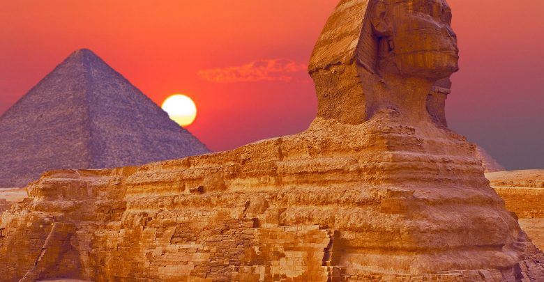 An image of the Great Sphinx of Giza with the Great Pyramid in the background. Shutterstock.