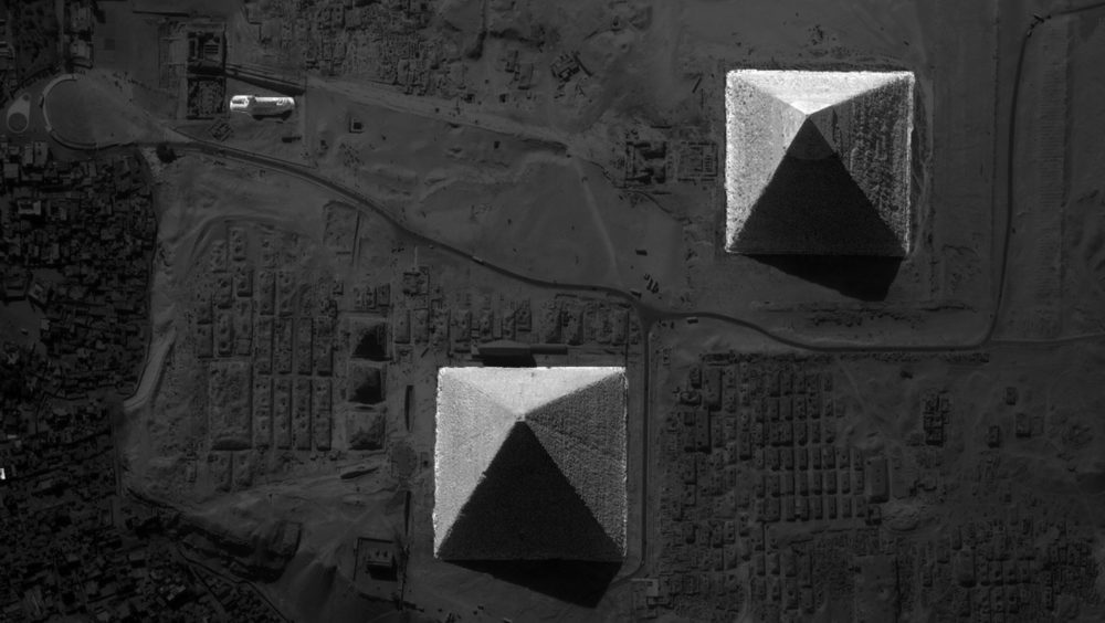 A birdlike image of the Pyramids at Giza and the Great Sphinx.