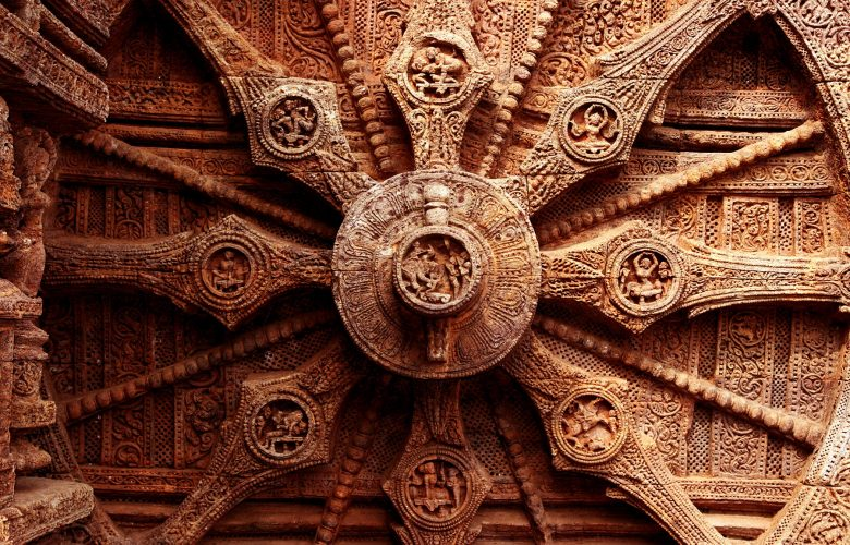 An image of the intricate carvings on the stone wheel of the Konark Sun Temple. Shutterstock.
