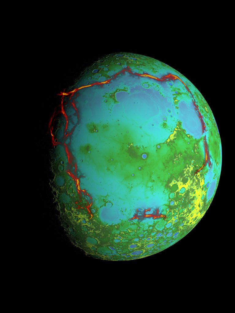 Gravity anomalies (red) bordering the Procellarum region overlaid on a global elevation map. Image Credit: Wikimedia Commons / Public Domain.