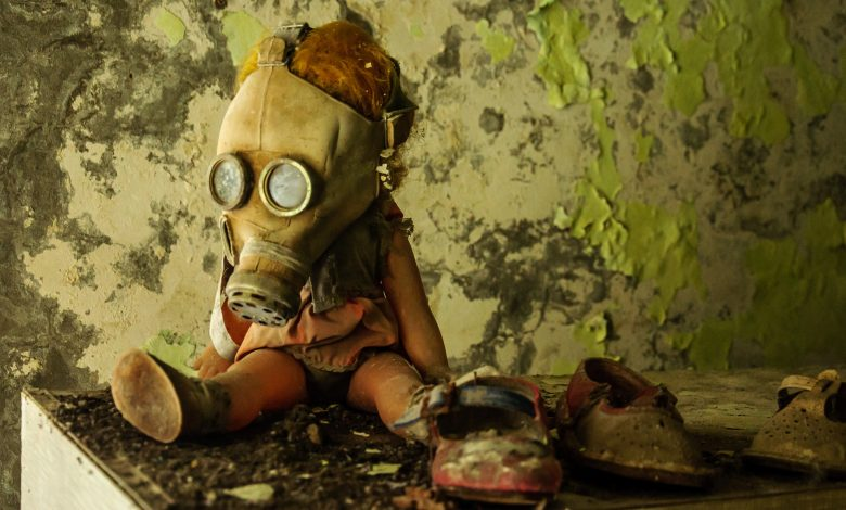 Chernobyl, Ukraine. A doll in a gas mask in abandoned city of Pripyat. Shutterstock.