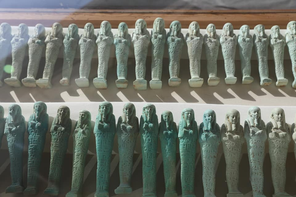 A photograph showing the figurines discovered by archaeologists during excavations. Image Credit: Egyptian Ministry of Tourism and Antiquities / Facebook.