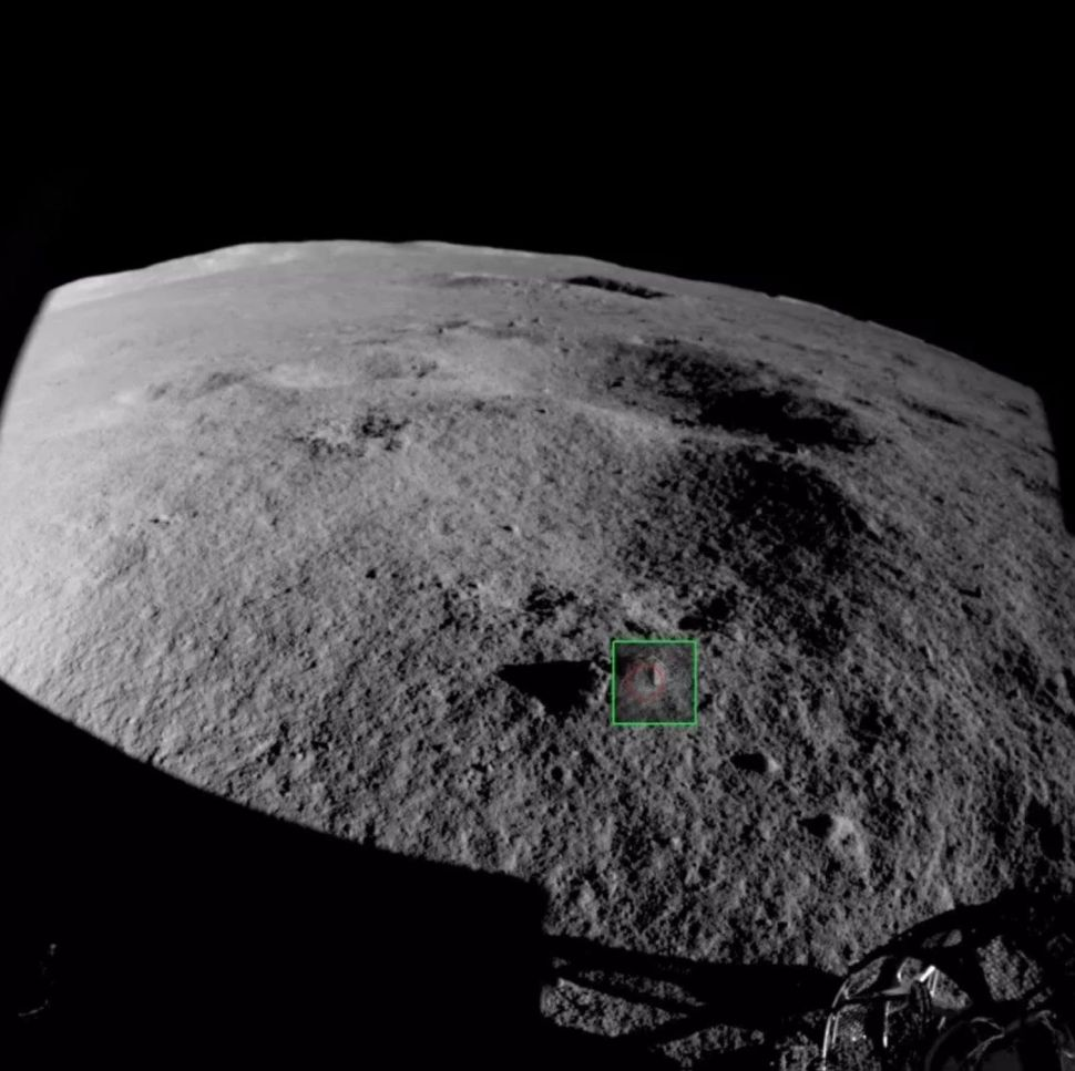 A view of the far side of the moon and the enigmatic rocks in question. Image Credit: CNSA / CLEP/ Our Space.