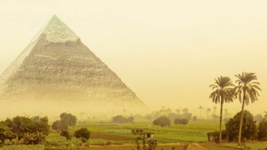 An artists illustration of the pyramid of Khafre and a fantasy landscape. Shutterstock.