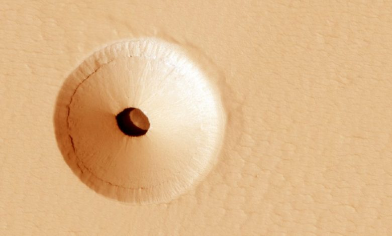 A NASA image showing a mysterious hole on the surface of Mars. Image Credit: MRO / NASA.