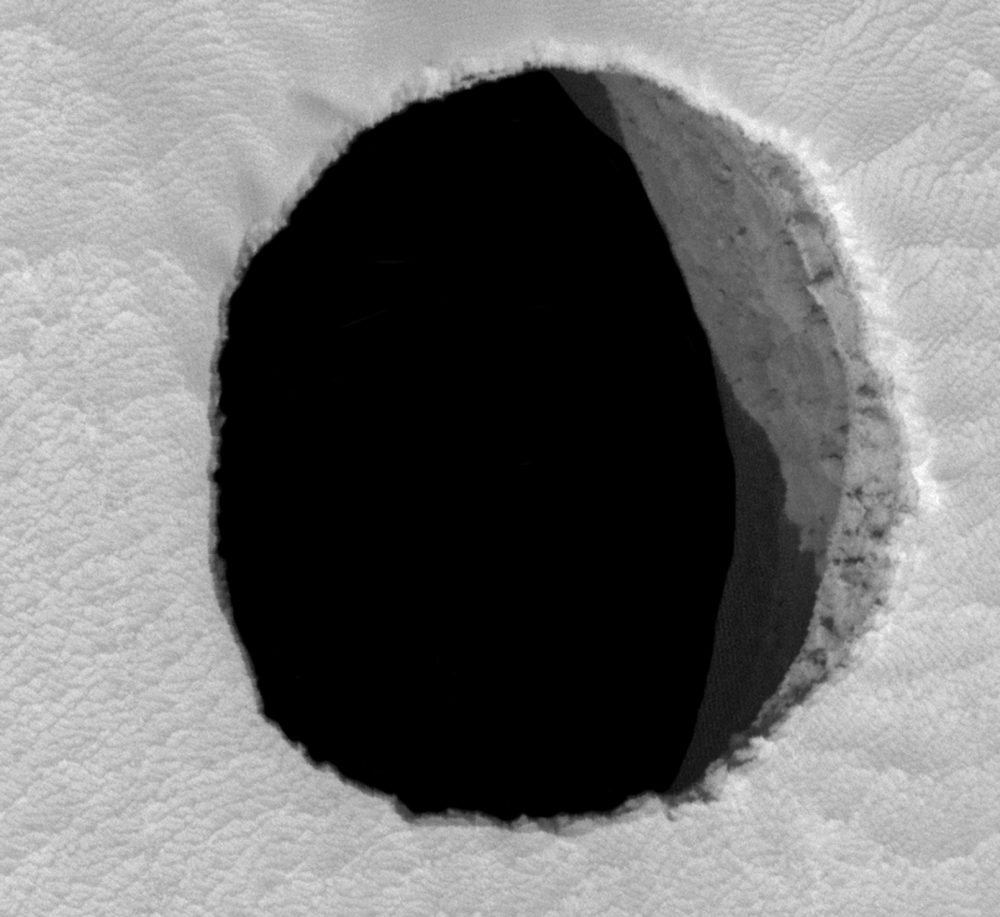 An image of a possible cave entrance in Mars' Arsia Mons region. The image was taken in 2007. Image Credit: NASA / Jet Propulsion Laboratory / University of Arizona.