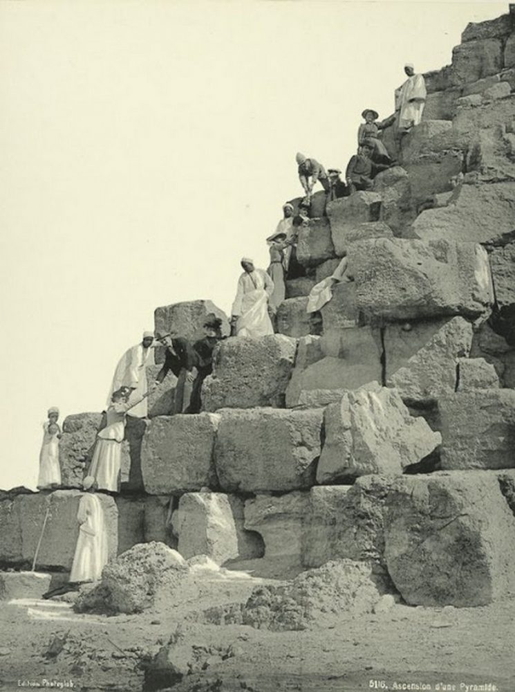 An image of a group of people climbing the pyramid. Photograph taken around 1870.