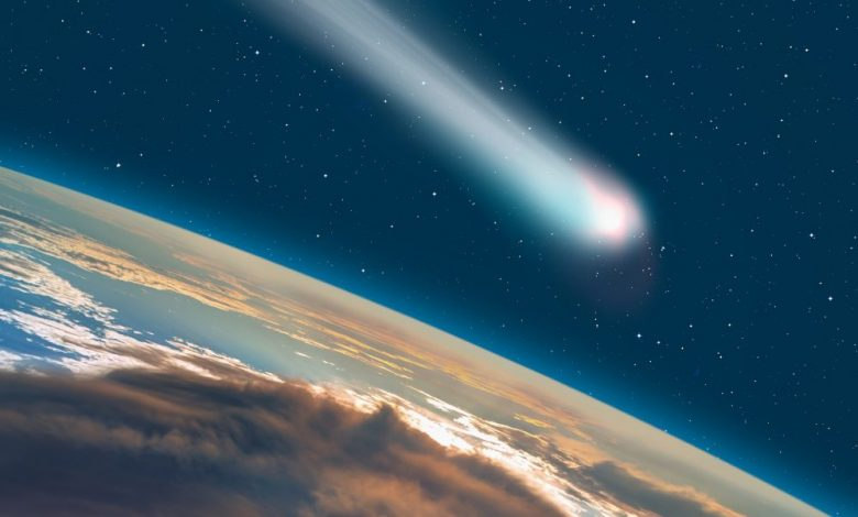 An artists rendering of a comet / asteroid passing next to Earth. Shutterstock.