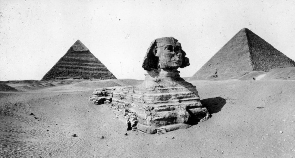 A rare photograph of the Great Sphinx, Khufu and Khafre's Pyramid before the Sphinx was fully excavated. Image Credit: Brooklyn Museum.