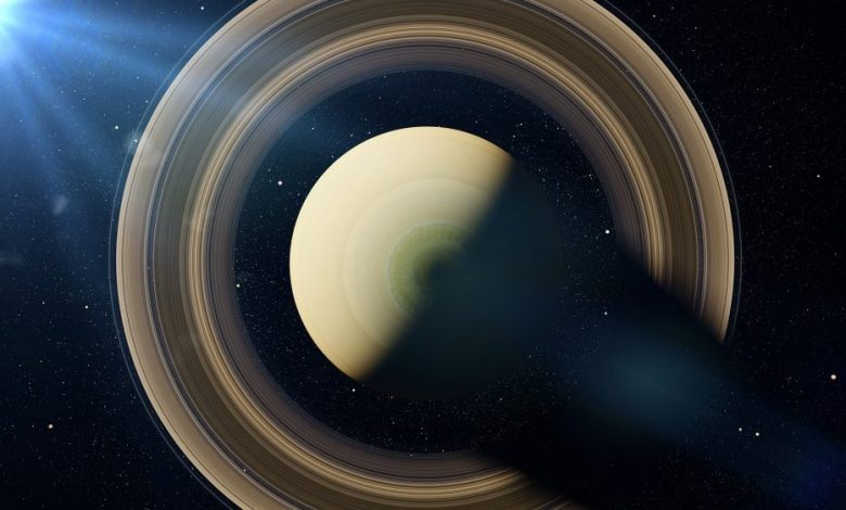 An image of Saturn, the sixth planet from the sun, illuminated by the Sun. Artist's rendering. Shuterstock.