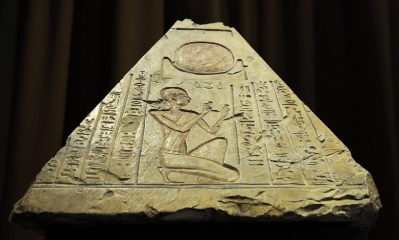 A front view of an ancient Egyptian pyramidion from the tomb of the priest Rer in Abydos, Egypt, 7th century BC. Shutterstock.