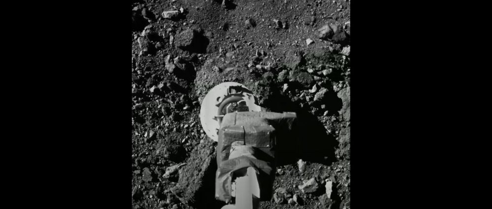 An image taken by OSIRIS-REx as it hovered above Asteroid Bennu. Image Credit: NASA.