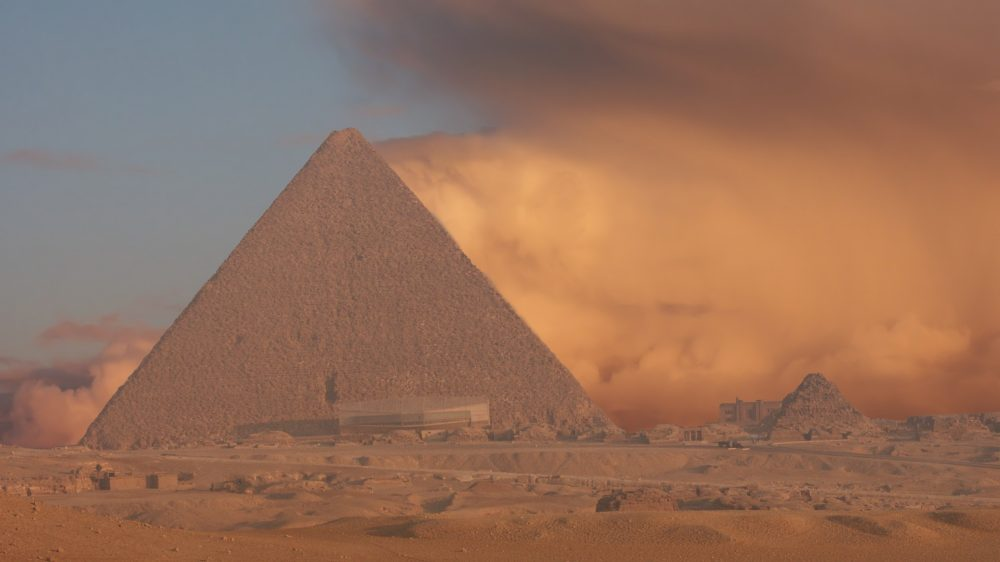 An image of the Great Pyramid of Giza with a sand storm in the background. Shutterstock.