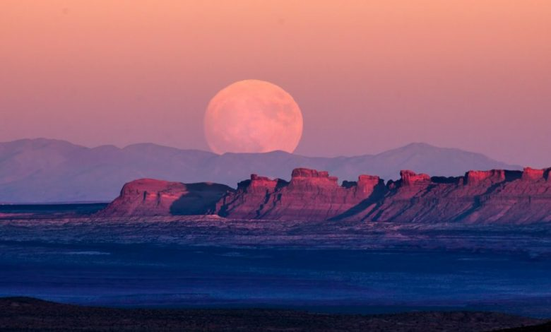 A photograph of the Supermoon rising over Monument Valley. Shutterstock.