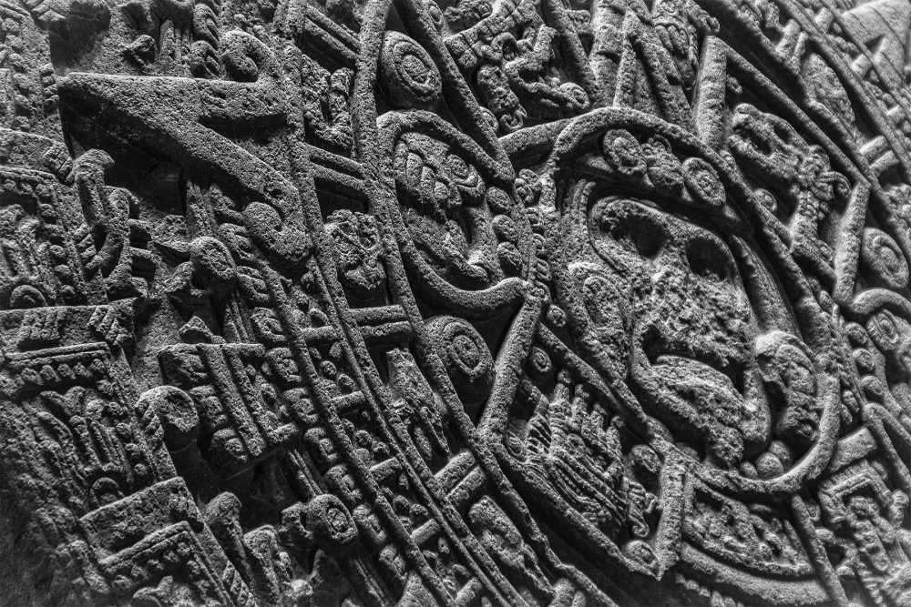 A close-up image of the Aztec Sun Stone. Shutterstock.