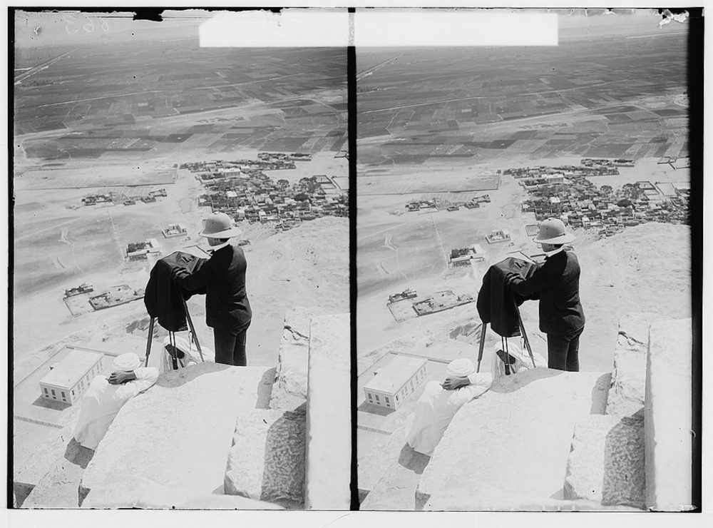 An image that shows American Colony Photo Department photographer Lewis Larsson with camera, looking down from near the top of the Great Pyramid. Image Credit: American Colony (Jerusalem). Photo Department / Library of Congress.