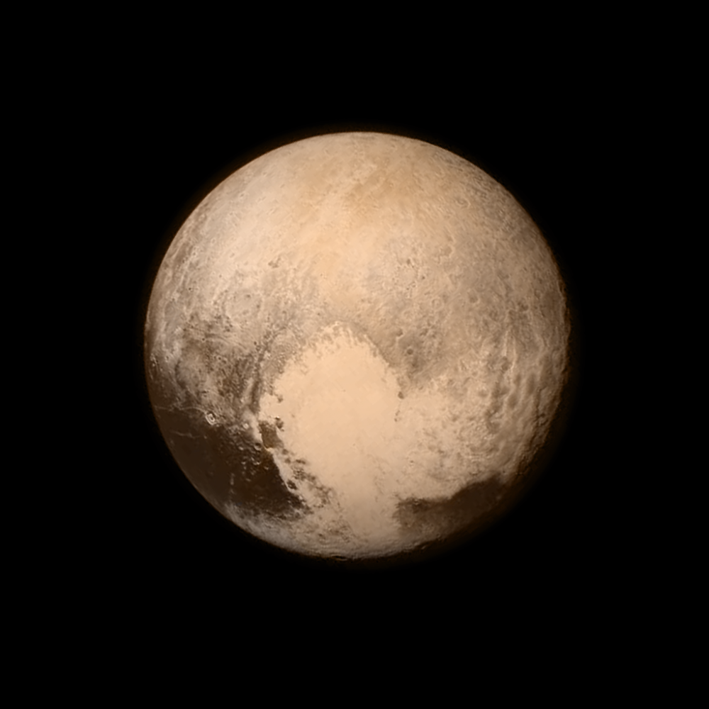 Pluto's Big Heart in Color. This Image was taken on July 13, 2015 at a distance of 476,000 miles (768,000 Kilometers) from the surface. Shutterstock.