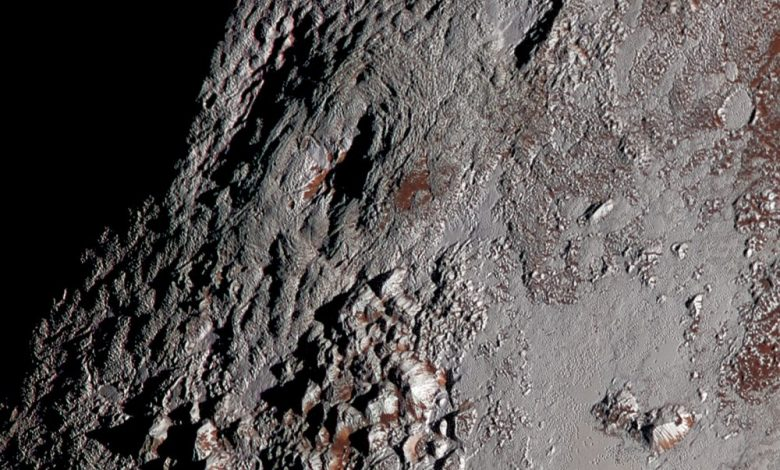 An image of Pluto's Wright Mons in color. It shows of one of two potential cryovolcanoes spotted on the surface of Pluto by the New Horizons spacecraft in July 2015. Image Credit: New Horizons.