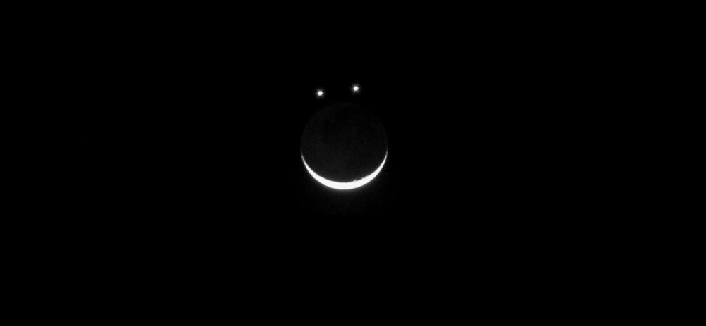 An image being shared online suggesting that the crescent moon will align with Jupiter and Venus to form a happy face in the sky. Image Credit: Curiosmos.