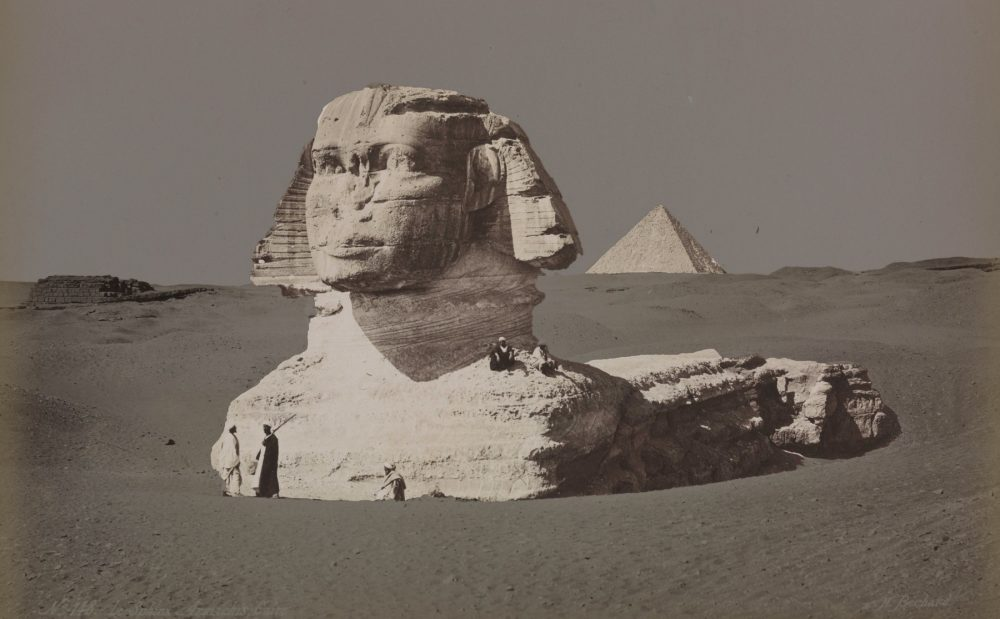 A rare view of the Great Sphinx and the Great Pyramid in the background. Image Credit: Hippolyte Bechard.