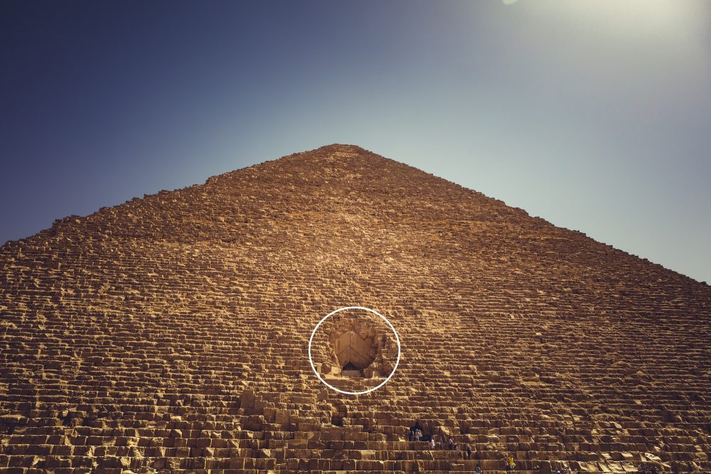 The entrance to the Great Pyramid of Giza circled in white. Shutterstock.