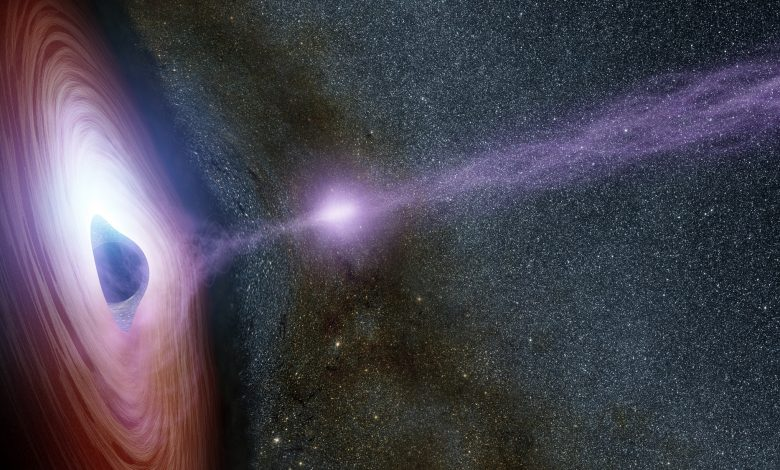A supermassive black hole is depicted in this artist's concept, surrounded by a swirling disk of material falling onto it. Credits: NASA/JPL-Caltech