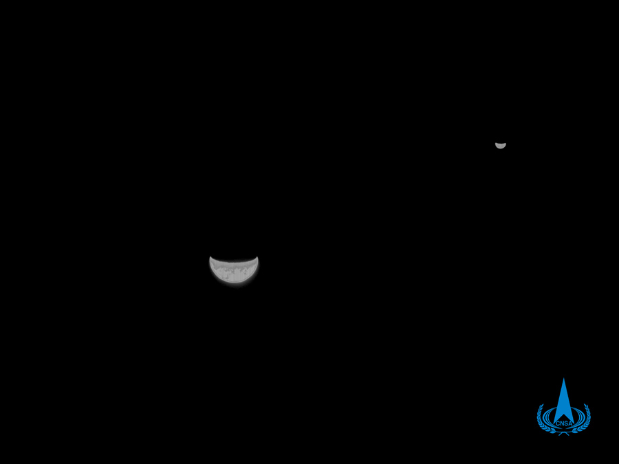 A black and white image showing both the Earth and the Moon. Image Credit: CNSA.