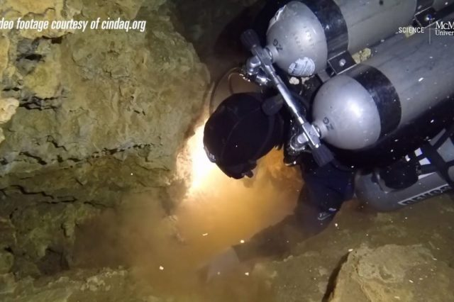 A screenshot showing a diver exploring the now sunken ochre mine in Quintana Roo, Mexico. Image Credit: McMaster University / Vimeo.