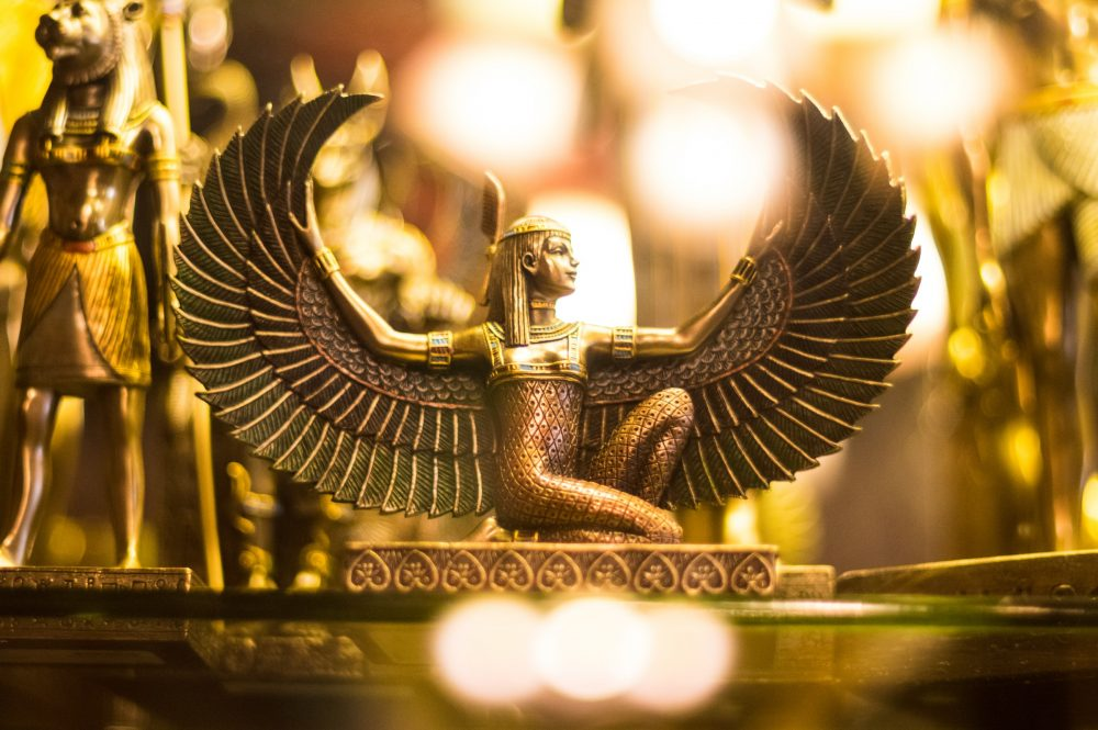 An image showing a statuette of the ancient Egyptian goddess Isis. Unsplash.
