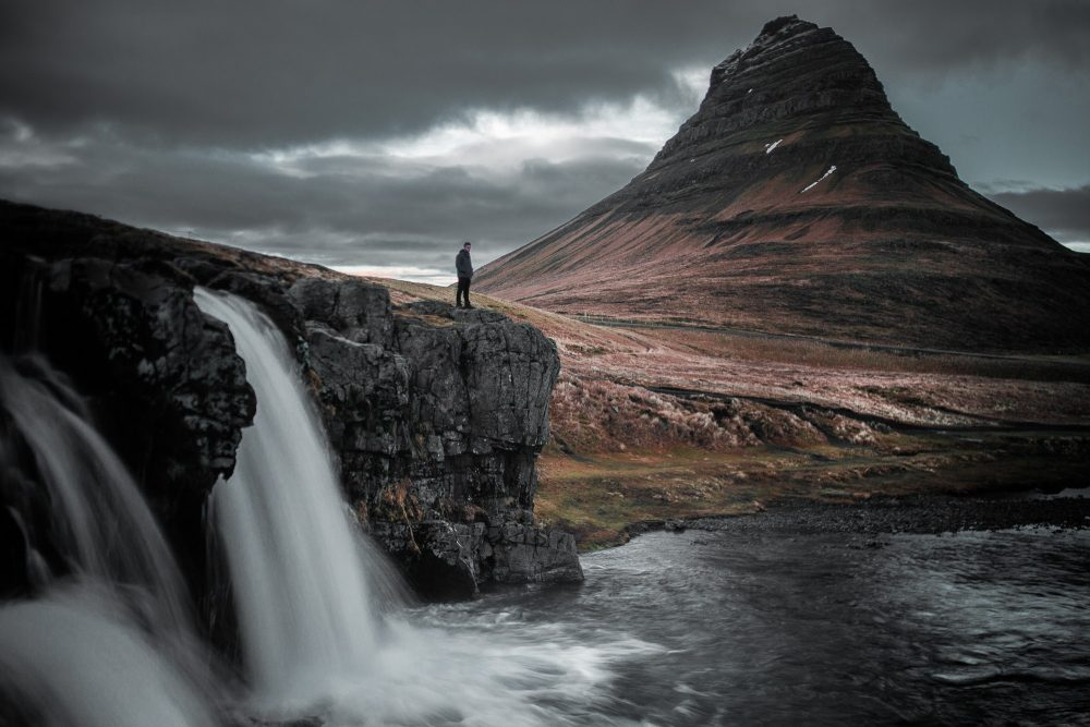 A stunning long exposure photograph of a waterfall in Iceland. Jumpstory.
