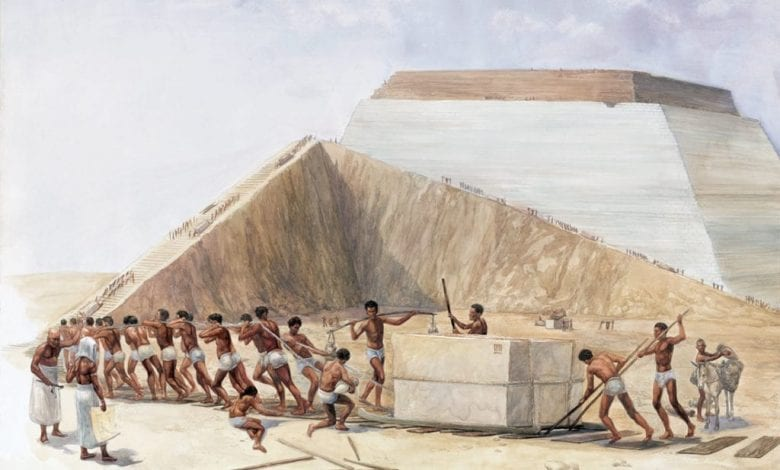 An artist's illustration showing the builders of the pyramids hauling massive blocks of stone up a ramp.