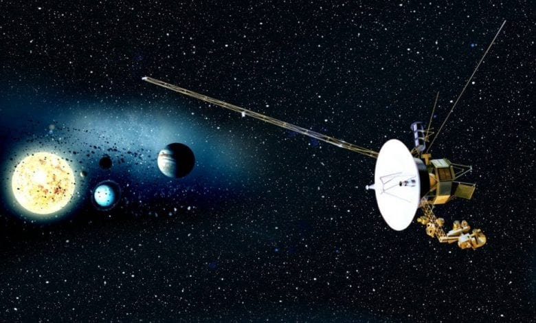 An artists rendering of the Voyager mission and the sun and planets in the background.