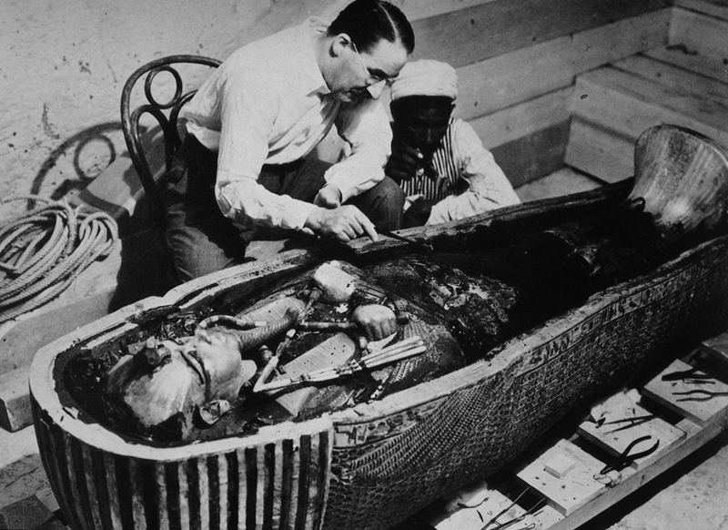The famous photograph of Howard Carter when he opened the coffins of Tutankhamun.
