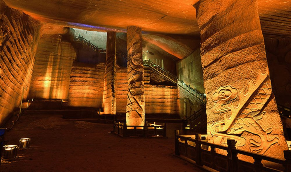 One of the largest caverns in the Longyou caves complex. You can see the mysterious wall decorations and grand pillars that have remained intact after thousands of years under water.