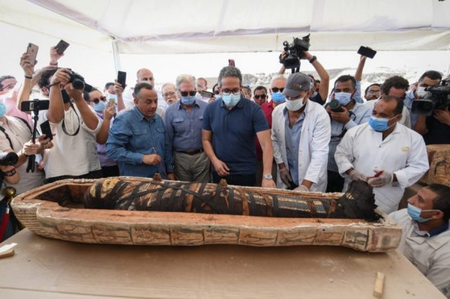 An image of one of the recently excavated sarcophagi from the royal necropolis of Saqqara and reporters and Egyptian high officials. Image Credit: Khaled El-Enany.