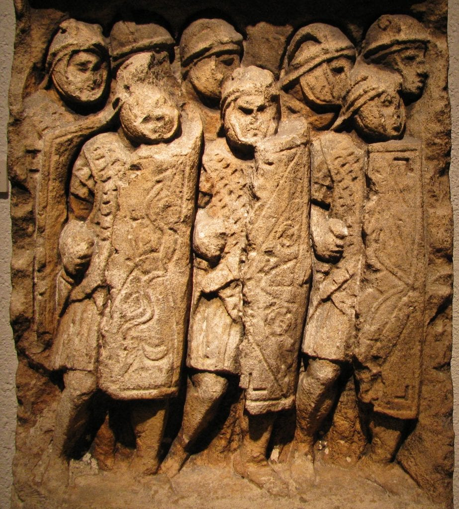Ancient stele depicting Roman legionaries in formation, found in the archaeological site at Glanum, France.