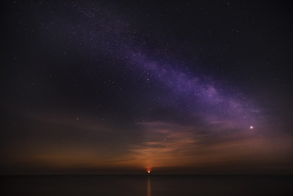 An image of sunrise and the stars in the sky. Jumpstory.
