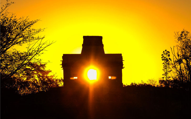 The sunrise on the day of the winter solstice as seen from the entrance of the Temple at Dzibilchaltun.