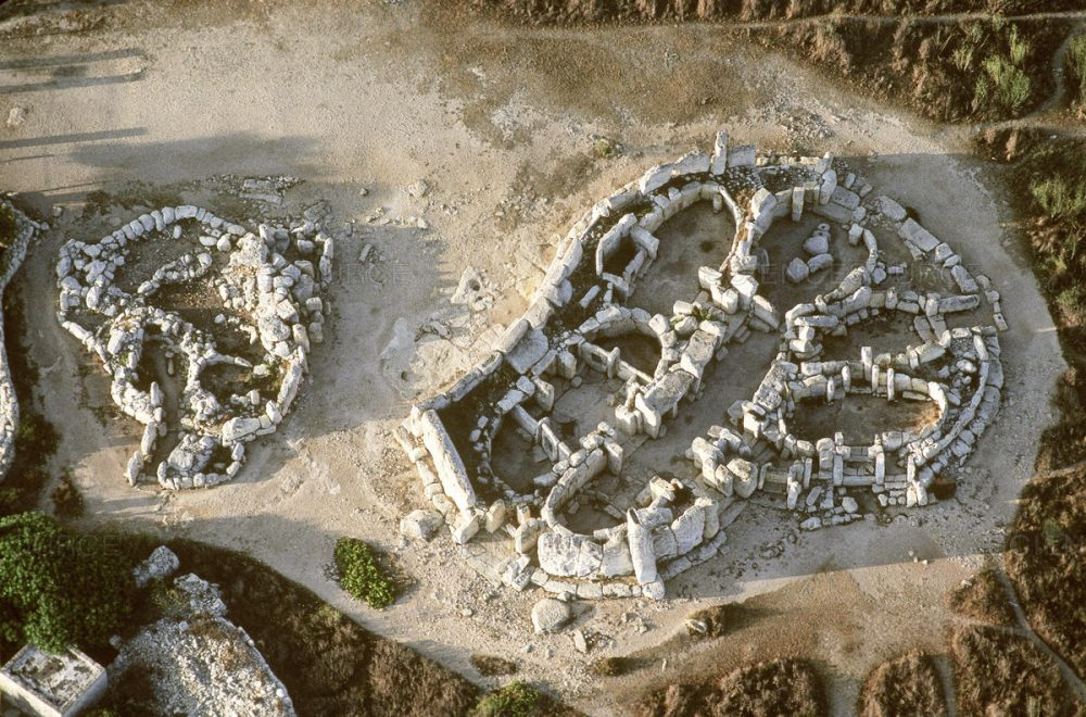 Aerial view of the Temple of Hagar Qim on the right.