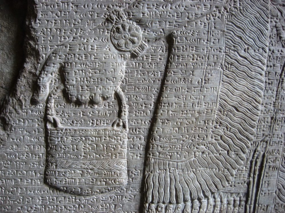 """An ancient sumerian illustration of a deity carrying a """"bag."""" Jumpstory."""