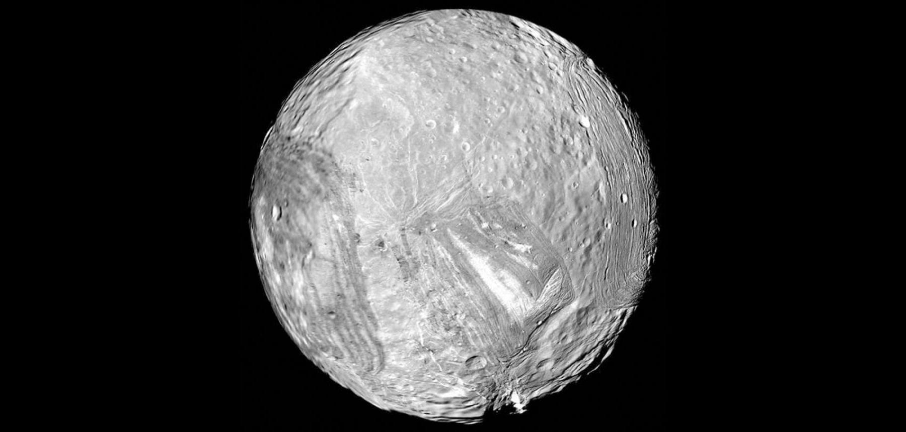 The strange moon Miranda with its damaged surface. Source: National Geographic