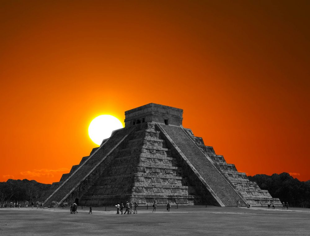 The sun rising behind the step pyramid in Chichen Itza, one of the many ancient monuments around the world built to align with the sun on the days of the solstices.