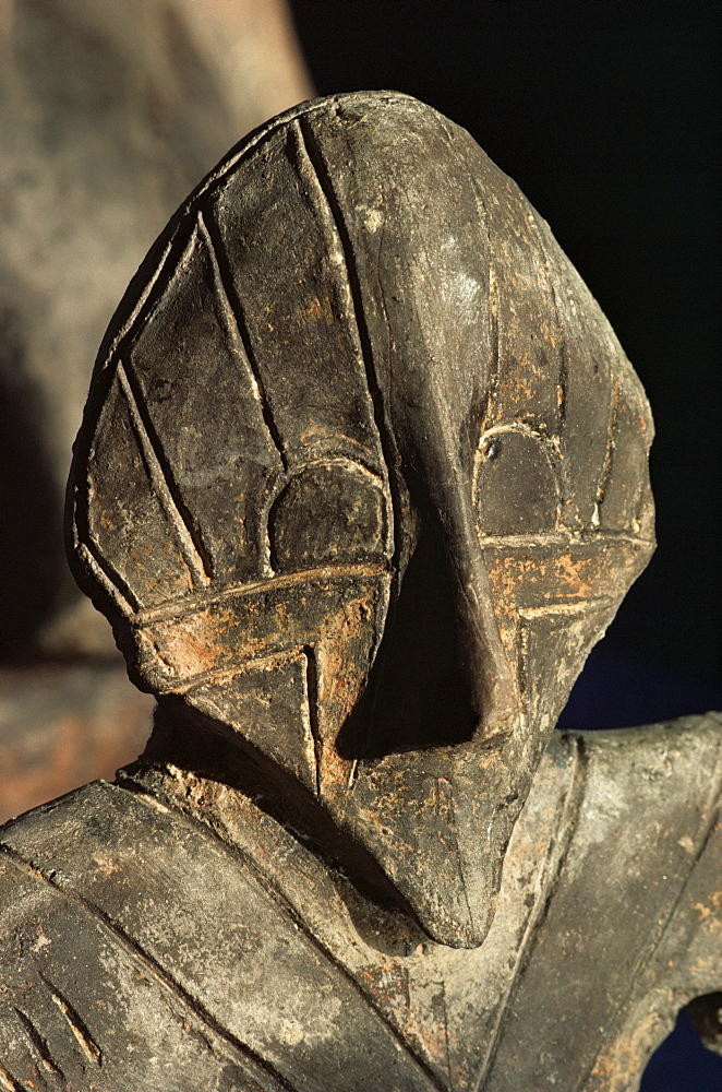 Here is a statuette that is clearly depicted wearing a mask. What could have influenced the ancient Vinca artists to depict beings in masks?