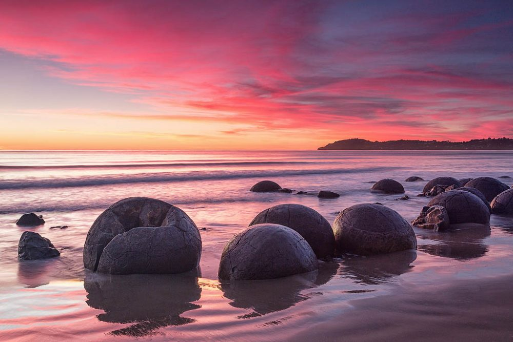 Mysterious stone spheres are located all over the world. The ones on the picture are from New Zealand. Credit: Megalithica.ru