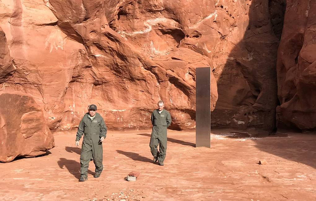 The mysterious monolith in the Utah desert and two of the crew members who discovered it. Credit: Utah Department of Public Safety