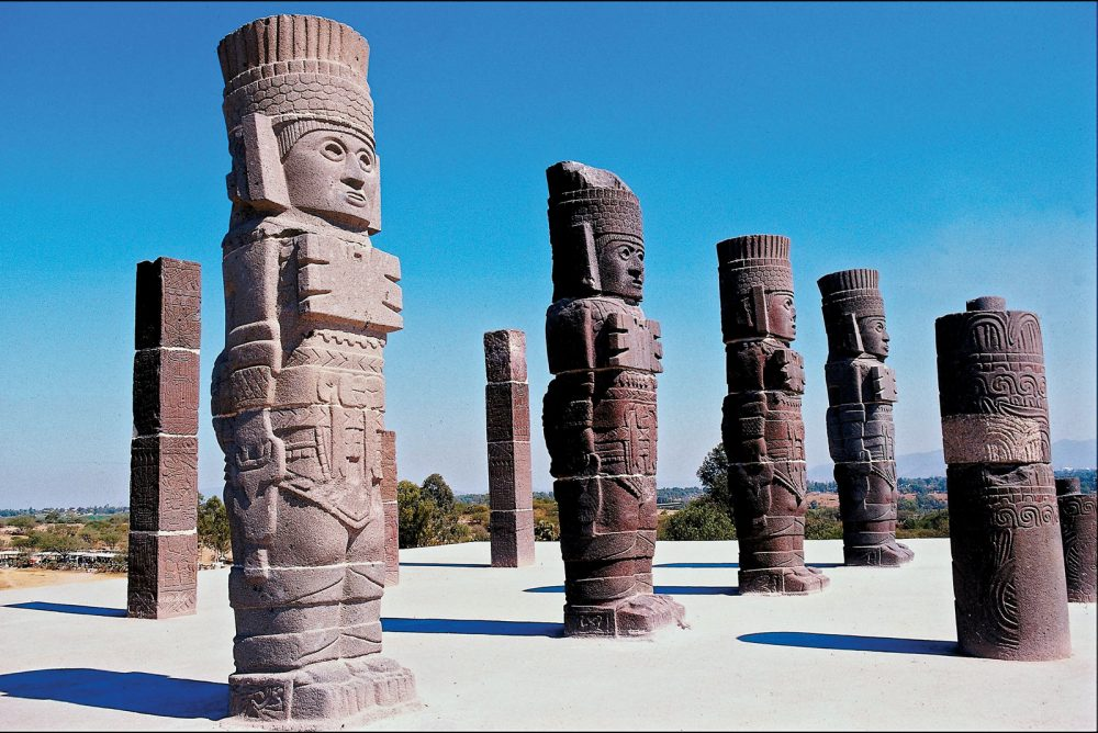 The massive statues of the Toltec Warriors holding the curious Handbags of the Gods. Where else has this motif been found? Credit: Britannica