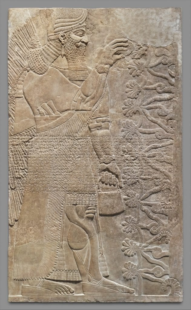 An Assyrian Relief Panel either depicting a king or an Anunnaki deity holding the Bag of the Gods. Credit: Metropolitan Museum