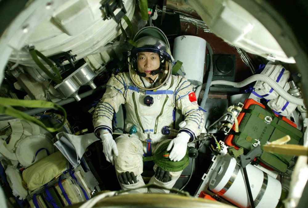 Astronaut Yang Liwei aboard the Shenzhou 5 spacecraft during his mission which was interrupted by the weird knocking sound. Credit: China.org.cn