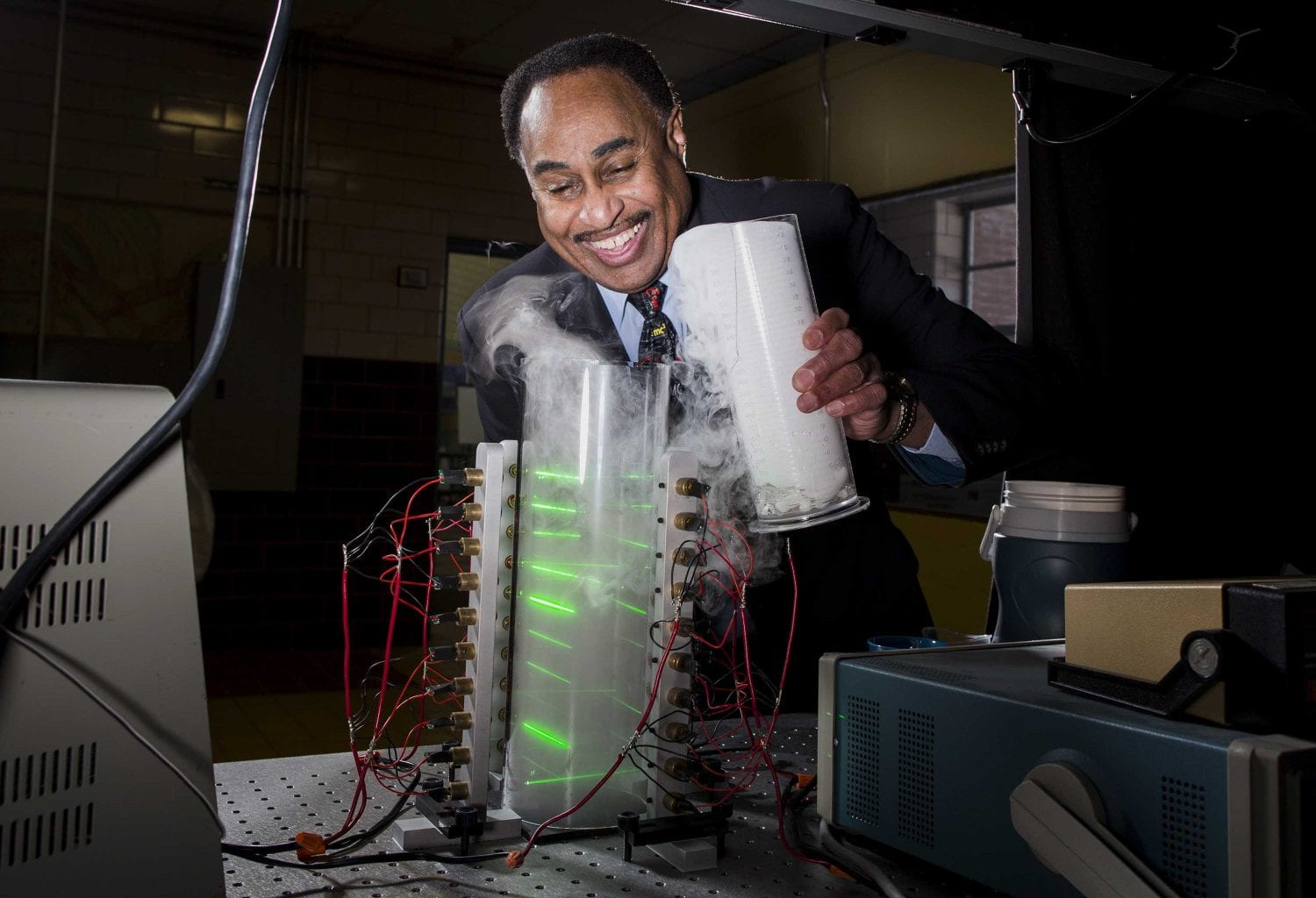 Ronald Mallett and his small prototype of a time machine with lasers. Credit: CNN
